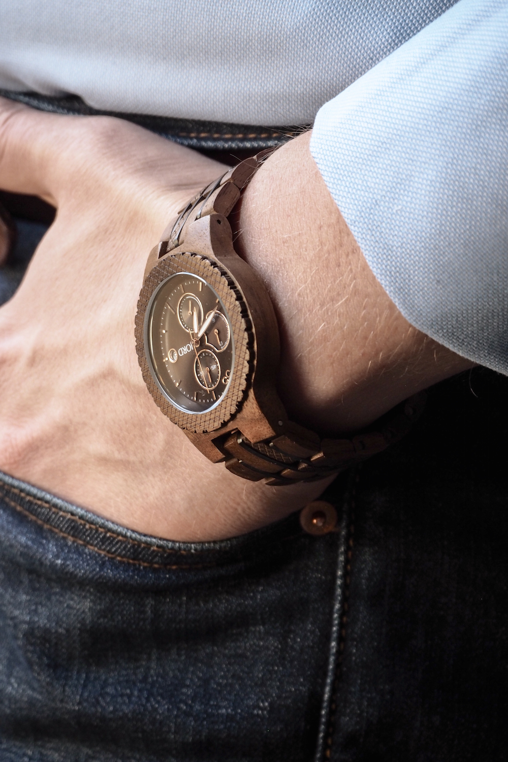 Wooden JORD Conway watch worn with dark blue jeans