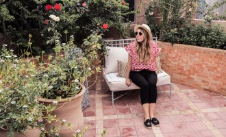 What to pack for Marrakech: Zara red top, Gap fedora, Ray Ban sunglasses, Hush black trousers, Soludos winking espadrilles