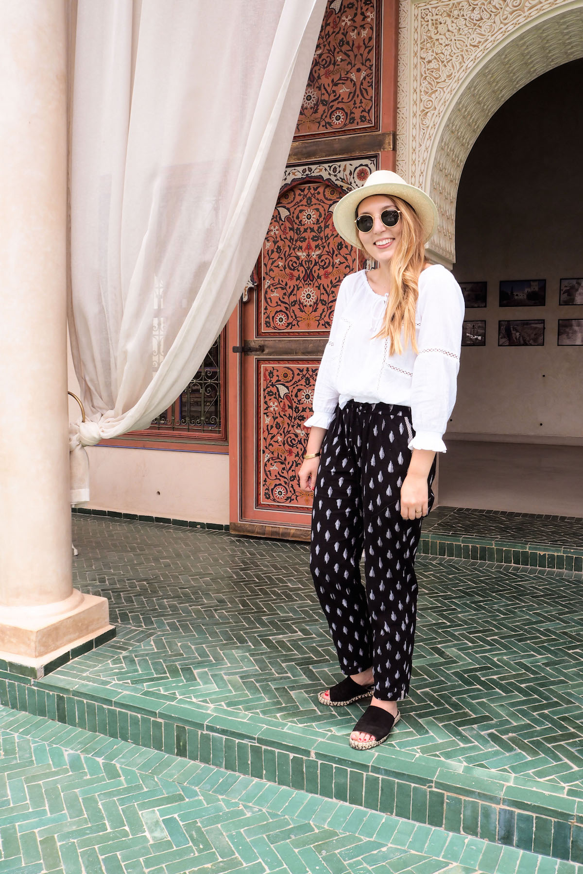 Kirei ikat trousers, urban outfitters white blouse, Gap hat, H&M black slides, Ray-Ban sunglasses | Wolf & Stag's Travel Guide to Marrakech, Morocco