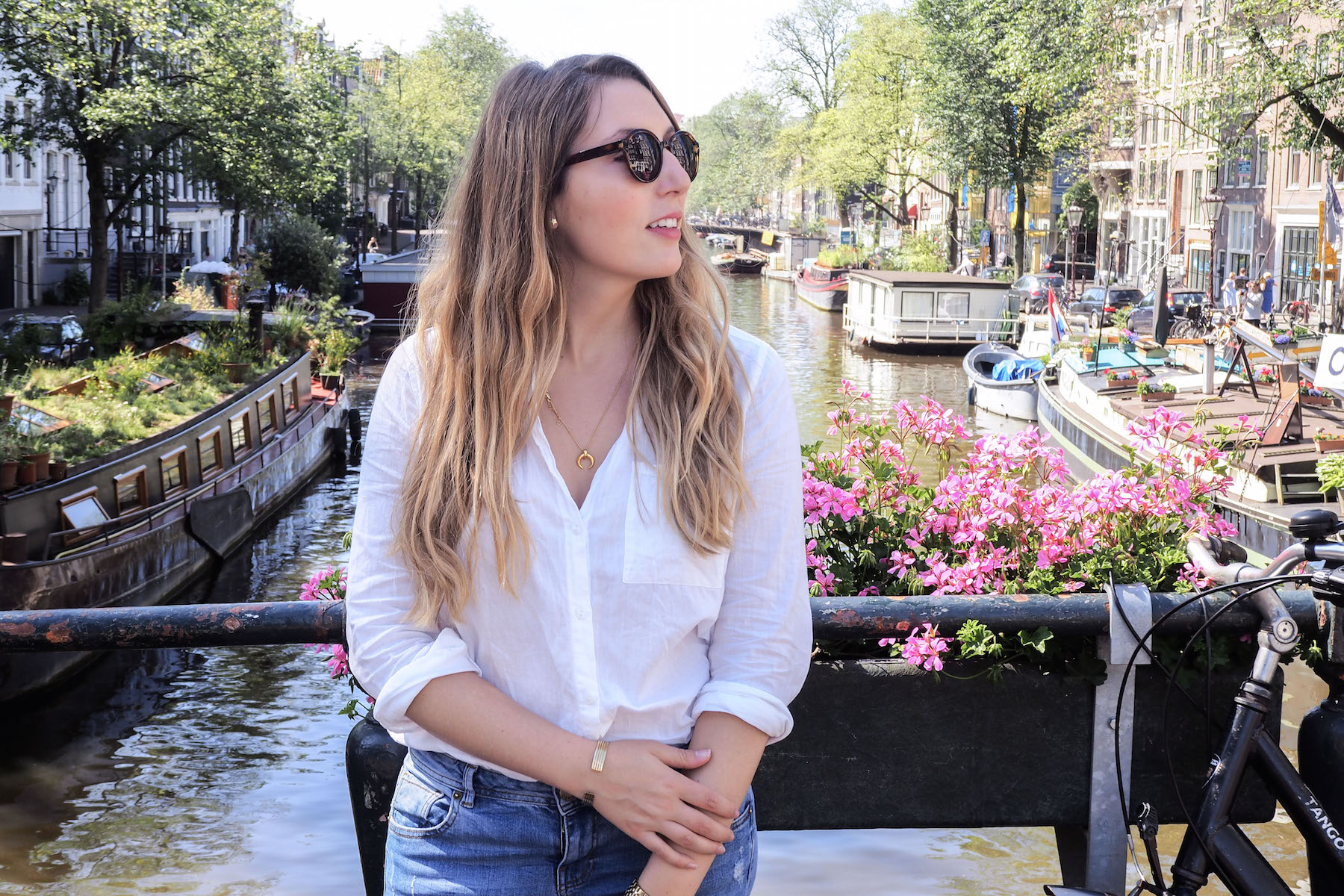 What I Wore in Amsterdam, Day 2: H&M cotton shirt, & Other Stories sunglasses, Warehouse boyfriend jeans, basket bag | Wolf & Stag