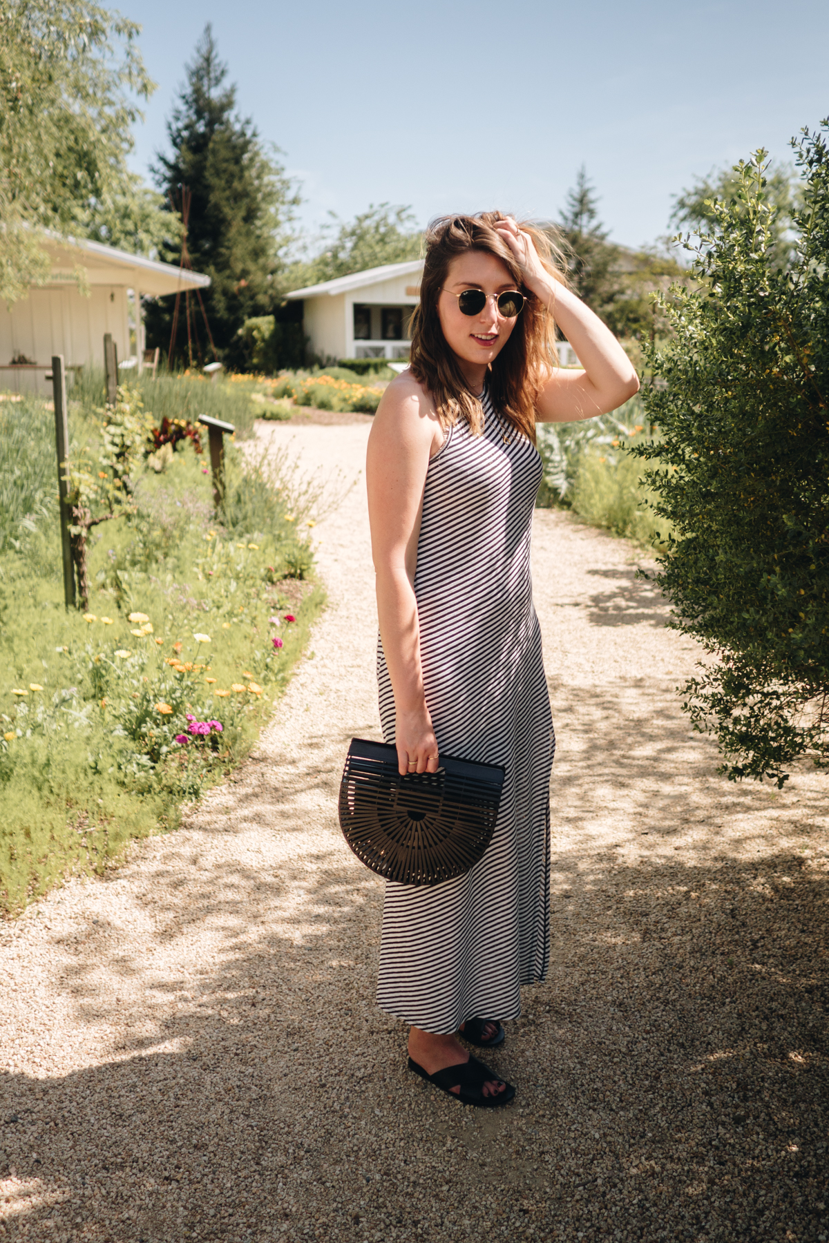 All Aboard the Napa Valley Wine Train   Wearing a striped & Other Stories maxi dress, black Cult Gaia bamboo bag and Rayn-Ban round shades   Wolf & Stag