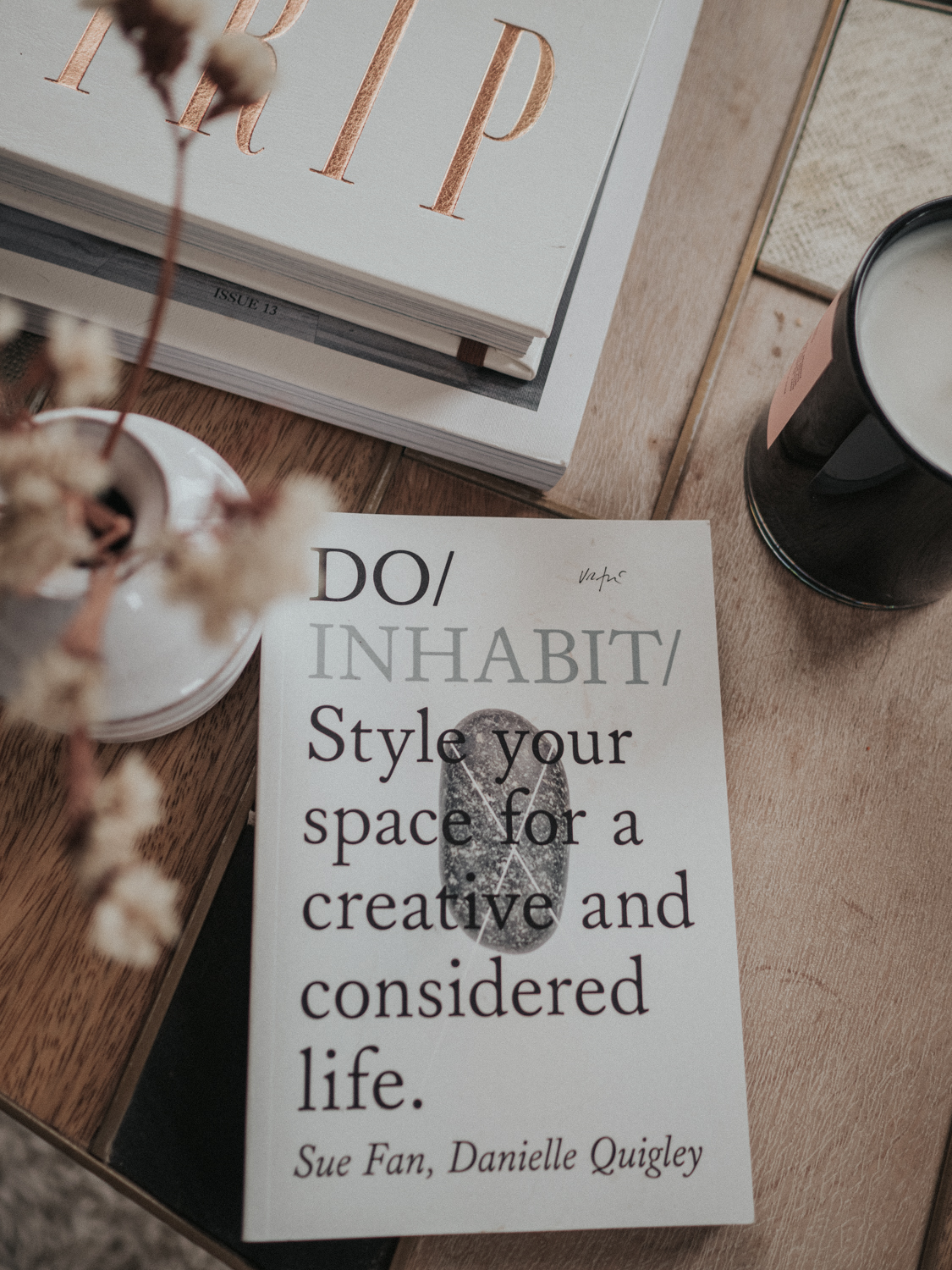 The Do Book Company: Do InHabit sits on a table with flowers and other books