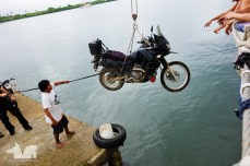 Marcos's KLR hanging precariously over the drink