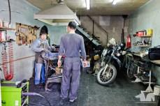 The aluminium welder fixing the chain guard bracket