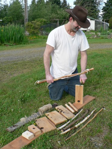 Chris Chisholm with a display of Bow Drill Kit Pieces