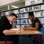 Students working in the library