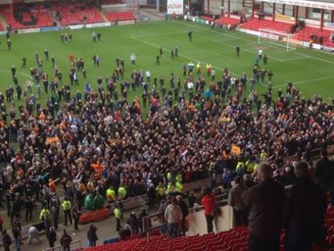 A pitch invasion of the acceptable, friendly kind as Wolves fans celebrate the final whistle at the Alexandra Stadium this afternoon.