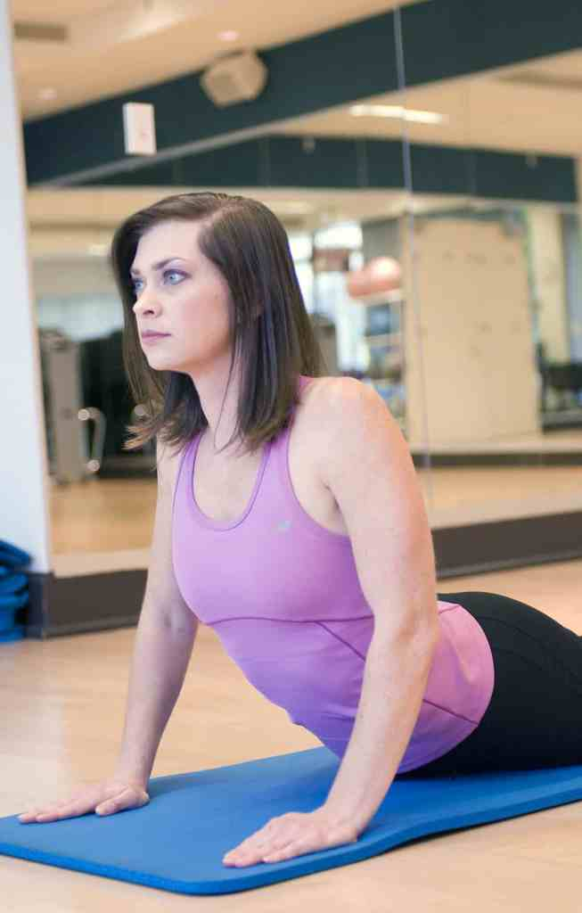 15408-a-woman-practicing-yoga-in-a-fitness-center-pv