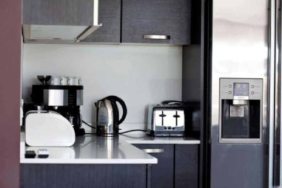 kitchen-with-black-cabinets-and-electric-appliances-700x465