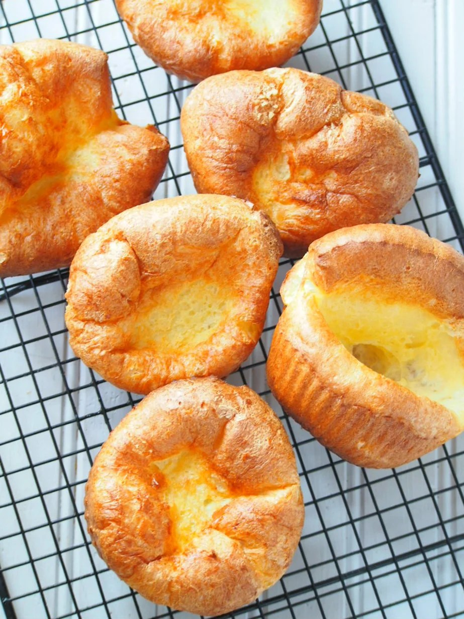 Enjoy these simple but delightful popovers as a sweet treat with maple syrup, whipped cream and fruits or as a side to a savory dish.