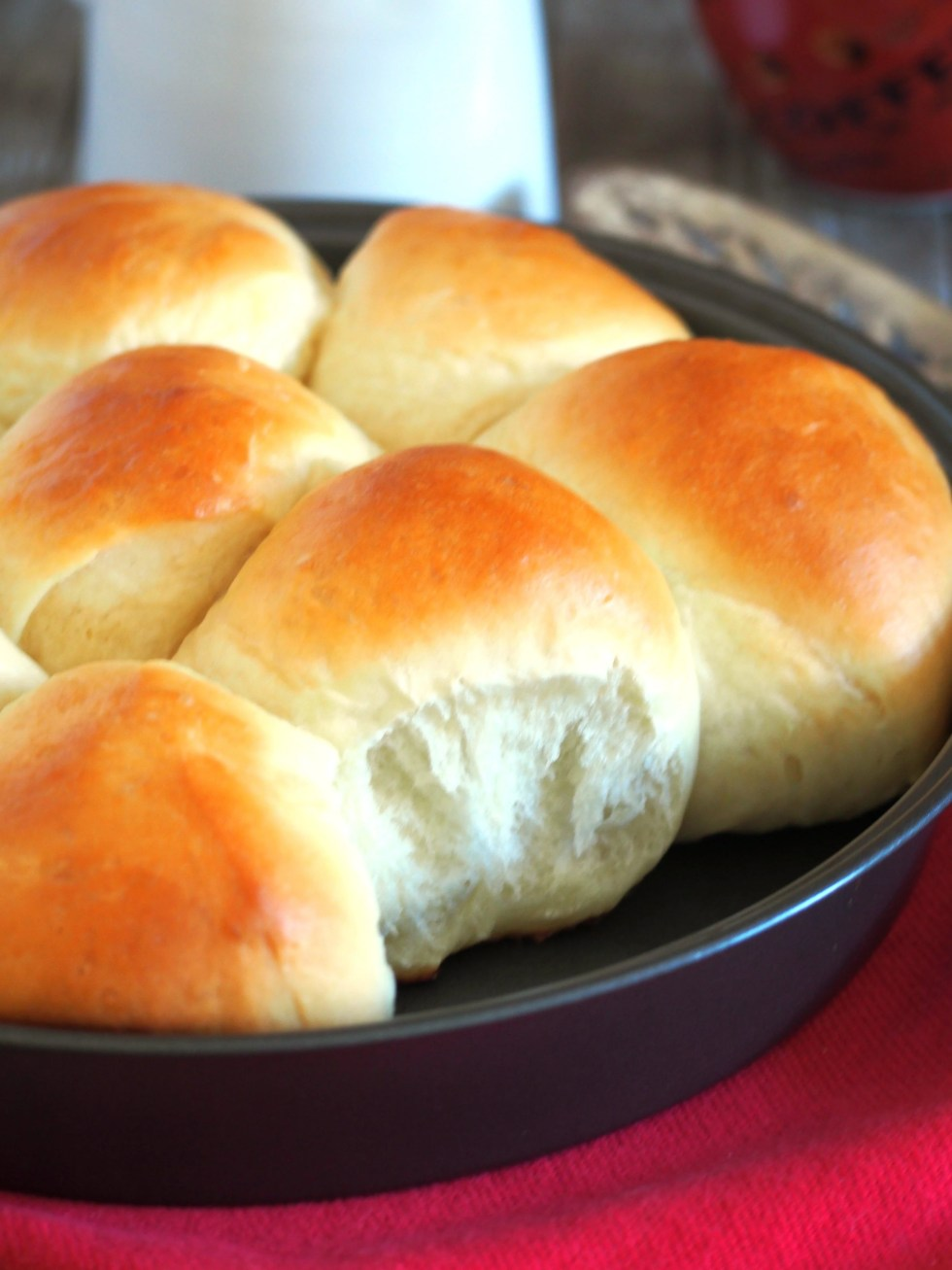 Japanese Milk Buns are soft and tasty dinner rolls perfect for eating on their own or with a pat of butter.
