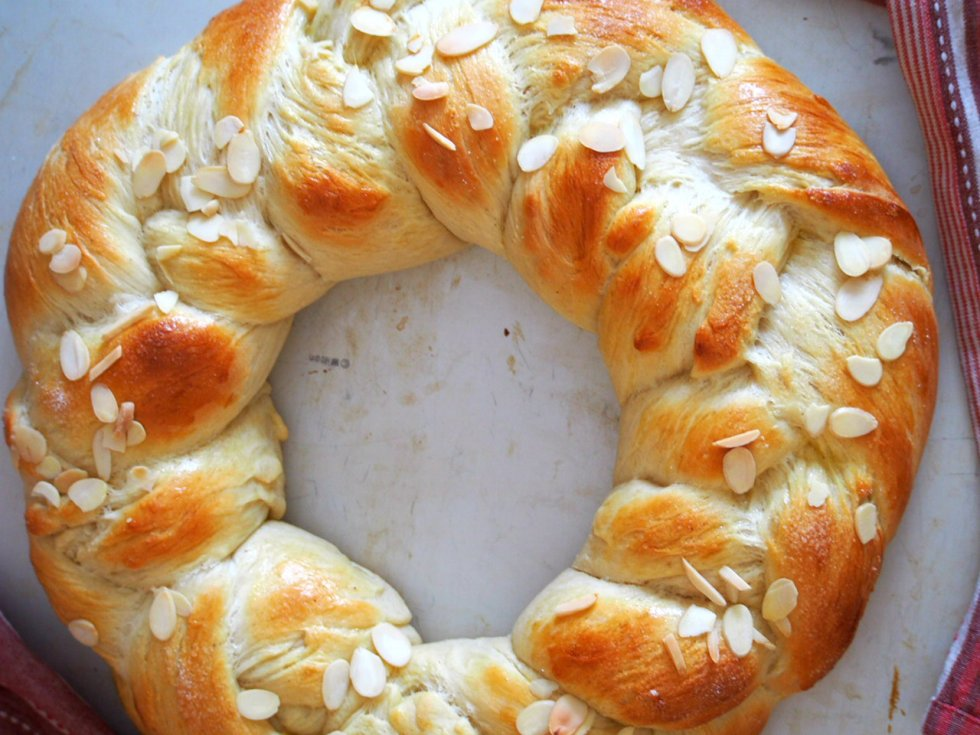 Finnish Pulla is a celebration bread braided beautifully like a wreath. It gets its nice flavor from the cardamom and it is adorned with crunchy almonds as finishing on top.