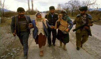 Armenian refugees from Azerbaijan arriving at a border post  after fleeing fighting between Azerbaijani and Armenian forces