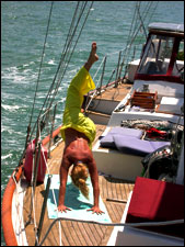 Kim Hess, of Yoga Onboard doing some downward dog action