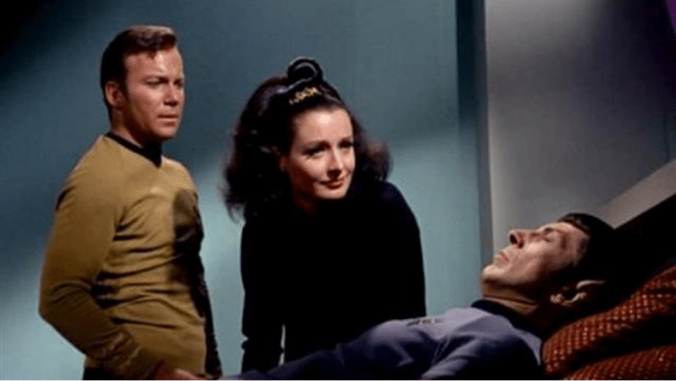 Kirk and Miranda lean over Spock in Sickbay