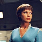 T'Pol in blue uniform standing alone