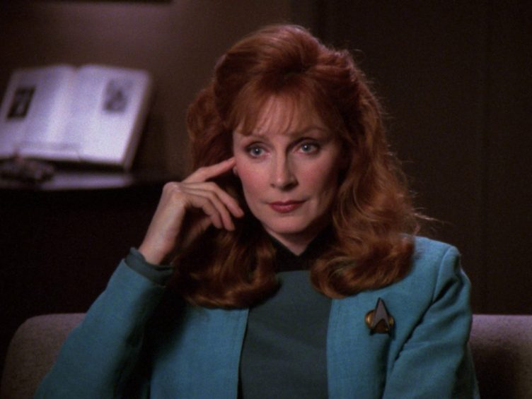 "Crusher listening to Picard in ""The Perfect Mate"""