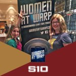 Grace and Jarrah in front of Women at Warp Banner