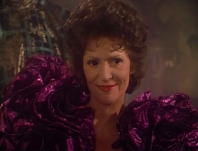 Lwaxana Troi in flouncy purple dress