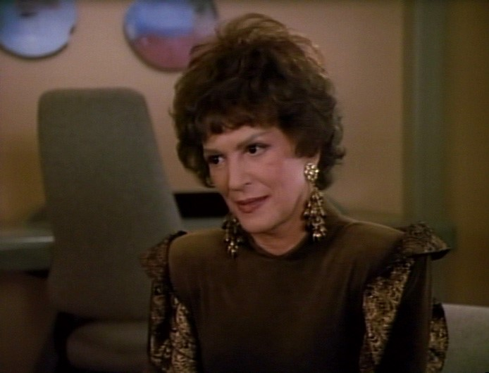 "Lwaxana in dark green in ""Half a Life"""