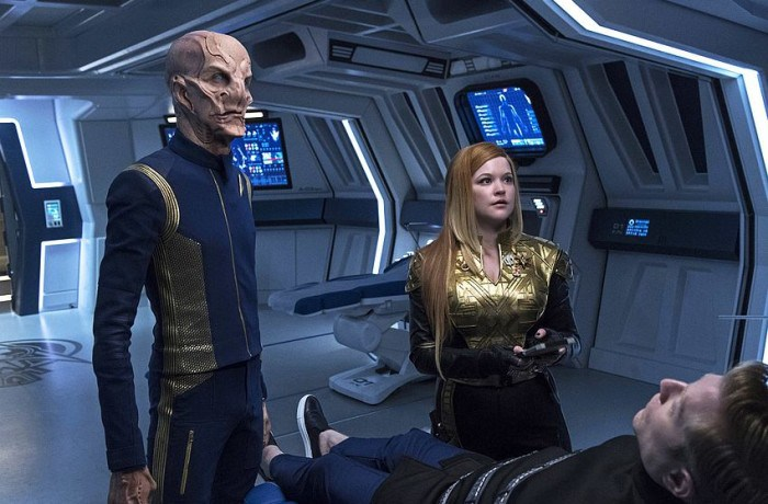 Tilly and Saru look at Stamets in Sickbay