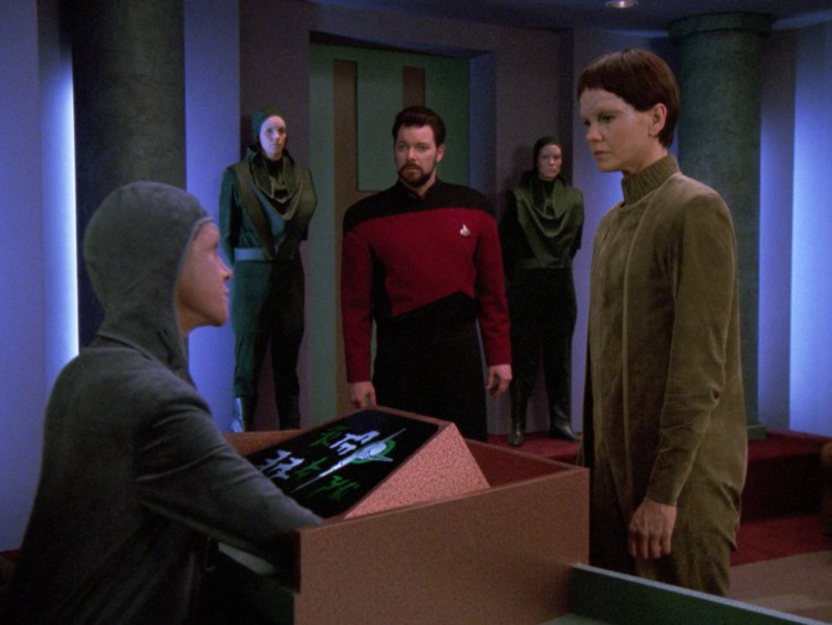Riker watches Soren speak to the arbitrator at her tribunal