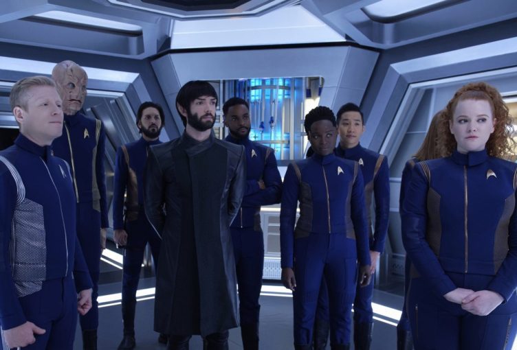The crew stands in the corridor to tell Michael they're going with her to the future.