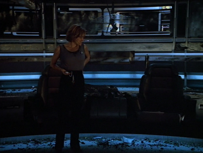 "Janeway on the bridge with her pocketwatch in ""Year of Hell"""