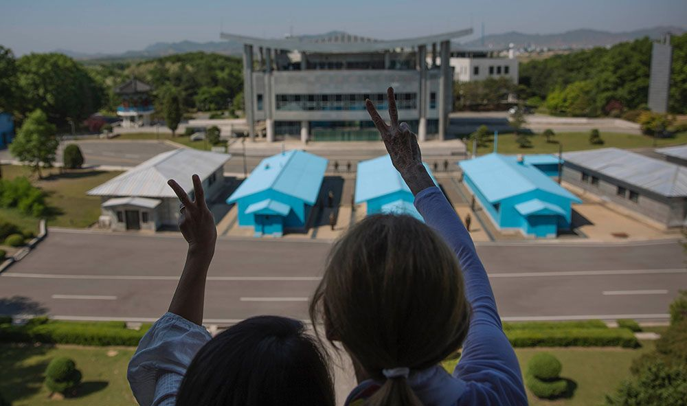 Christine Ahn and Gloria Steinem share a message of peace at the Joint Security Area. Photo by David Guttenfelder.