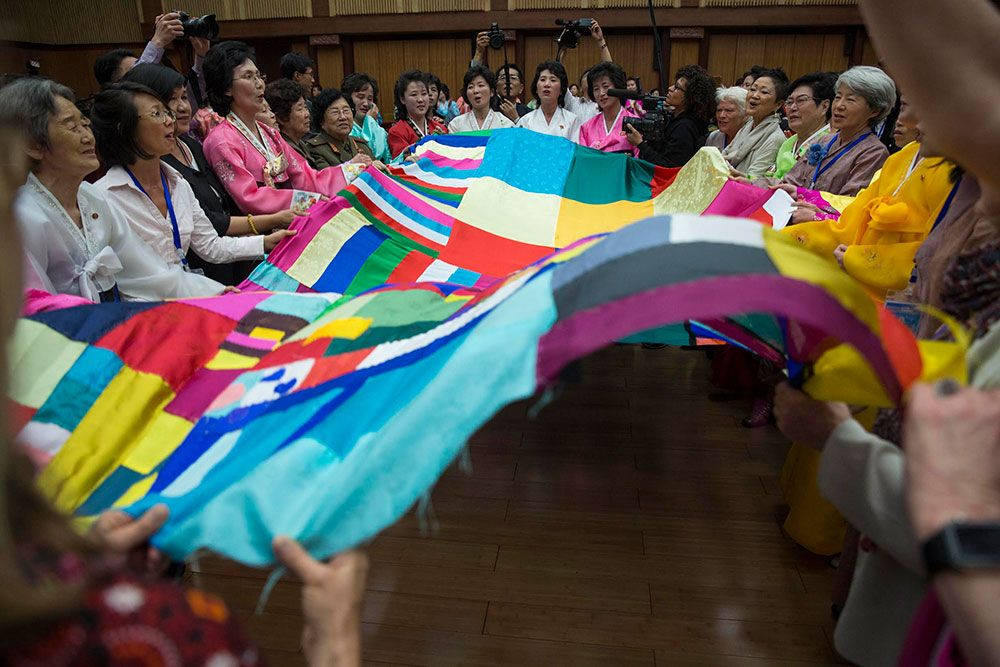 Quilt-stitching ceremony at the Women's Peace Symposium in Pyongyang. Photo by David Guttenfelder.