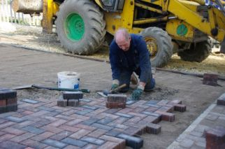 Alan block paving the quadrangle.