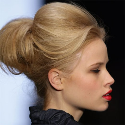Young blonde woman demonstrtating updo hairstyle