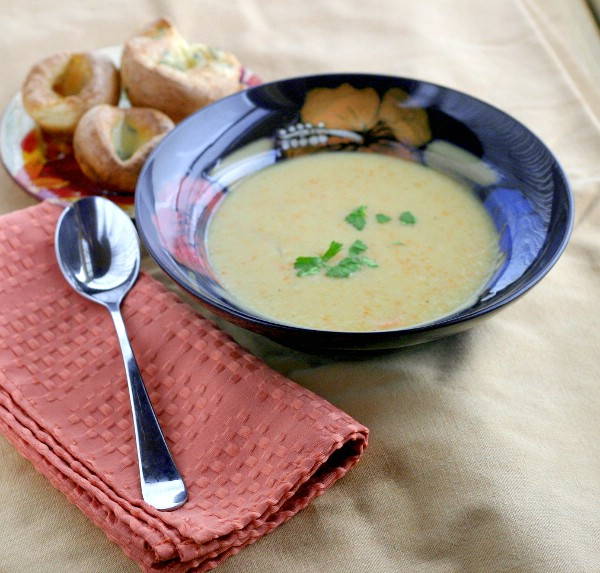 finished served apple cider and cheddar soup with parsley mini-popovers