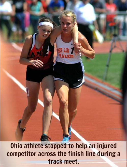 athlete helping out injured athlete