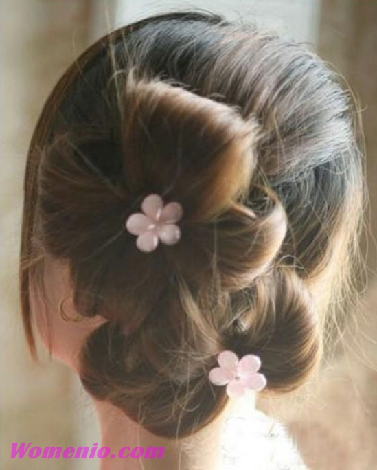 Finished double ponytail updo decorated with flowers