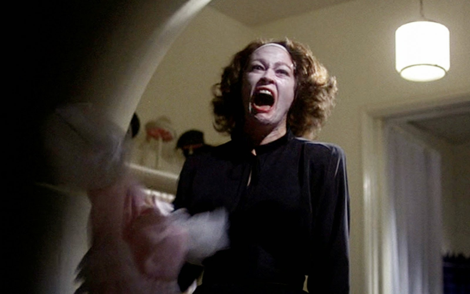 The Shadow in Film: Joan Crawford, Mommie Dearest. Faye Dunaway portrays the legendary actress in this biographical drama that portray's Crawford's abusive relationship with her daughter. In the movie she is is a driven actress and compulsively clean housekeeper who tries to control the lives of those around her as tightly as she controls herself.