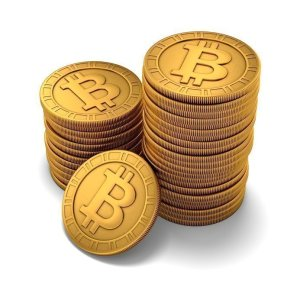 Small group of paneled golden Bitcoins on white