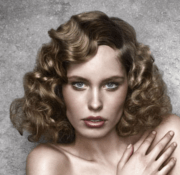 women 50s with big curls and long