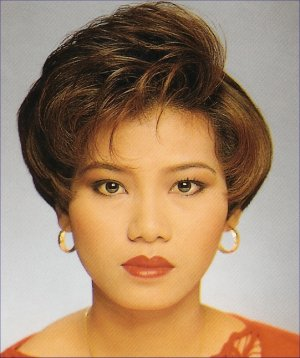 Very Short Hair Style With Wavy Bangs Black Asian Lady