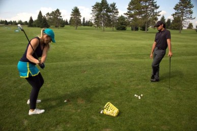 marvin sanguesa and caroline chisanga golf lesson