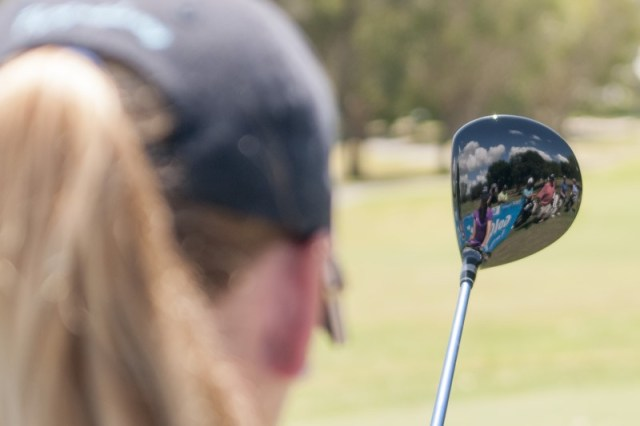 Lining up with her Williams Racing Golf driver.