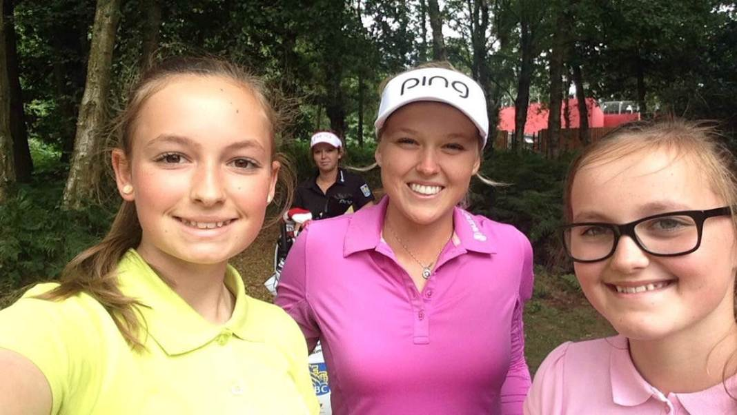 Hope and Eve Neild with Brooke Henderson - womens golf newsletter