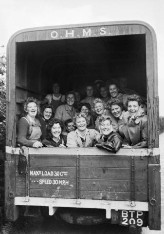 A group of happy Land Army girls in the back of an OHMS truck, Devon, England. Source: IWM D 21958