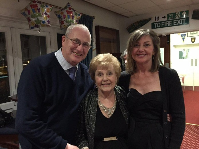 Zeita Holes celebrating her 90th birthday in March 2015, together with Stuart Antrobus, who researched the history of the WLA in Bedfordshire, and her daughter, Pauline Robins, who had come over to Bedford with her family and grandchildren, from her home in California.