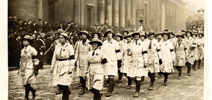 The march of the Land Girls in the Lord Mayor's Show. A company of members of the WLA, in white smocks, with a wagon containing weather-browned and smiling women workers, formed a picturesque feature of the show. Source: Catherine Procter Collection