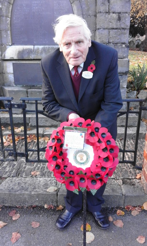 photo of Stuart with the wreath he laid at West Malling in Kent.  The photo was taken in front of the War Memorial just prior to the service.