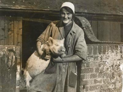 "Daisy with pig. This photo published in the local paper captioned ""His last picture"". Pencil note 1921."