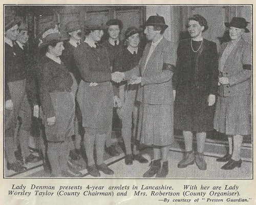 Lady Denman presents 4 year armlets in 1944.