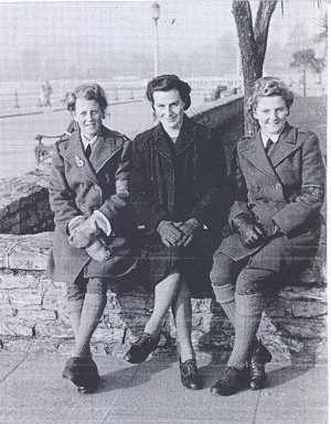 Three Land Girls on the winter seafront at Torquay during their stay at the WLA Rest House in December 1948. Mabel Bracey, on the left, was later to be one of the young women representing Bedfordshire WLA in the final disbandment parade at Buckingham Palace, on Saturday 21 October, before Queen Elizabeth, Patron of the WLA. Source: M Stratford. Courtesy of Stuart Antrobus