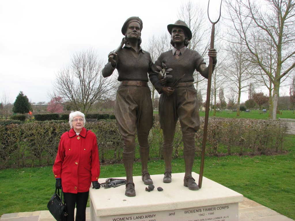 Mary Whalley (née Hancock) standing next to WLA and WTC memorial at NMA
